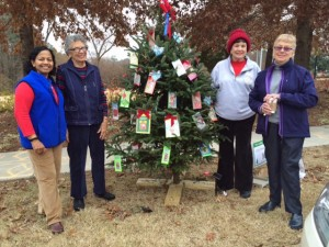 """Club members decorate the Cary Woman's Club's """"Gifting Tree"""" project in downtown Cary, December 2014"""